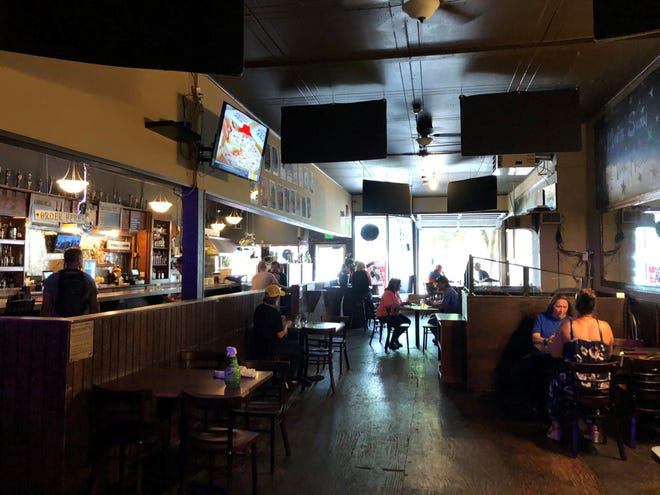 Patrons at the the Manette Saloon, where tables are  distanced apart to ensure social distancing. The bar reopened in late May after Kitsap County moved into the second phase of the state's four-part coronavirus recovery plan.