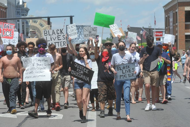 Protesters march in downtown Bucyrus during a Black Lives Matter protest on Saturday. Protesters marched down Sandusky Avenue from Washington Square to Liberty Street, then back to the square.