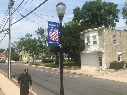 A welcome banner flies Saturday above Woodlynne Avenue in Woodlynne.