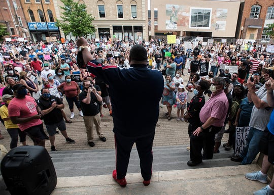 """A large group of protestors cheered as Pastor Tray Gray from Zion Church gives the """"I Have a Dream"""" speech made famous by Dr. Martin Luther King Jr. on the steps at the Ross County Courthouse on June 6, 2020."""