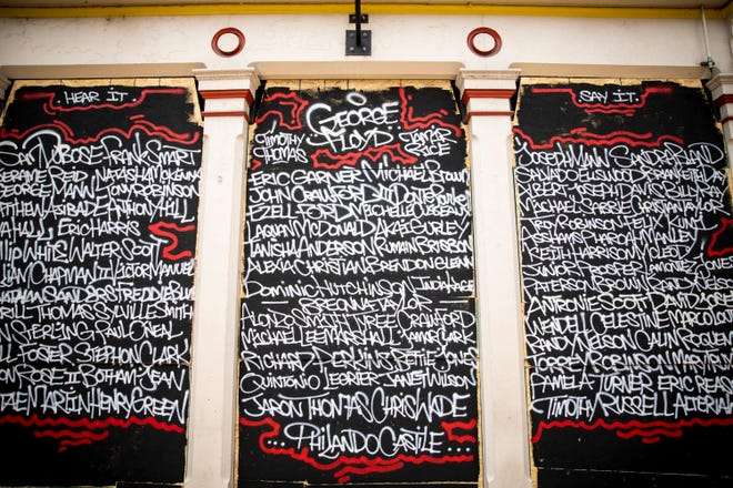 Names of those killed by police officers cover the wooden boards blocking the windows of Crying Heart Tattoo shop in Over-the-Rhine on Friday, June 5, 2020.