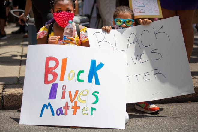 Xoe Burley, 10 and her brother, Xavier, 9, Kennedy Heights, participate in the Black Men in Suits and Women in Heels protest, Saturday, June 6, 2020. The march started at Fountain Square and went to the Hamilton County Courthouse. Protests across the country have been ongoing since May 25 when George Floyd was killed by Minneapolis police. All have been fired and Derek Chauvin charged with second degree murder.