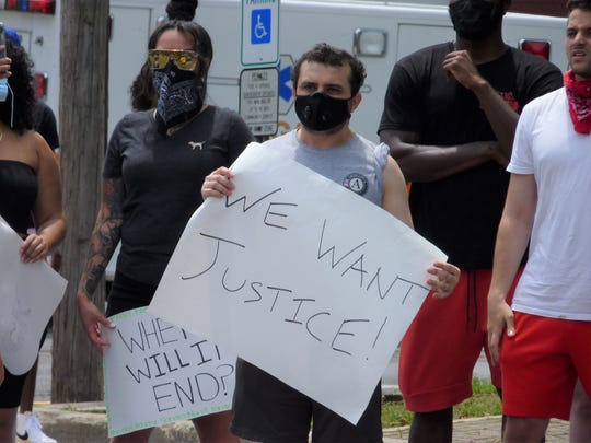 An activist with a sign at the Sayreville Black Lives Matter rally on June 6, 2020.