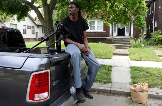 Marcus Williams, 25, from Detroit was out cutting grass for the real estate company he works for near the area of Gratiot and Burns on Thursday, June 4, 2020. Williams has been following the protests in the city intently and thinks the peaceful protests are making a difference.