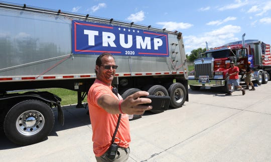 Before it got crowded with many motorcycles and people Trump road rally organizer Ken Licari does a selfie of himself in front of a semi hauler with a Trump 2020 sign on it.Over 500 people participated in a Trump road rally from Ira to Shelby Township, Michigan on Saturday, June 6, 2020.Many motorcycles, cars and trucks caravanned to a meeting point at 23 Mile and Van Dyke where speakers talked to the large crowd.
