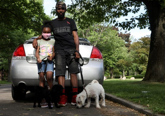 Armondo Twitty, 29 and his daughter Anaia Twitty, 9 who live in the North Rosedale Park neighborhood in Detroit have been following the protests in Detroit and the nation about the death of George Floyd with local and national media.Both her out with their dogs at a nearby park on Wednesday, June 3, 2020.