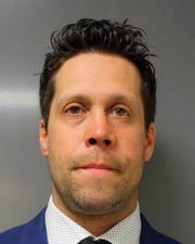 This June 6, 2020 photo provided by the Erie County District Attorney's Office in Buffalo, N.Y., shows suspended Buffalo police officer Aaron Torgalski.