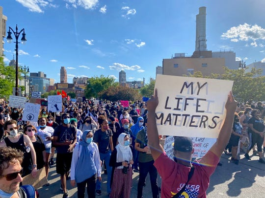 Marchers take to the streets in Detroit to protest police brutality.