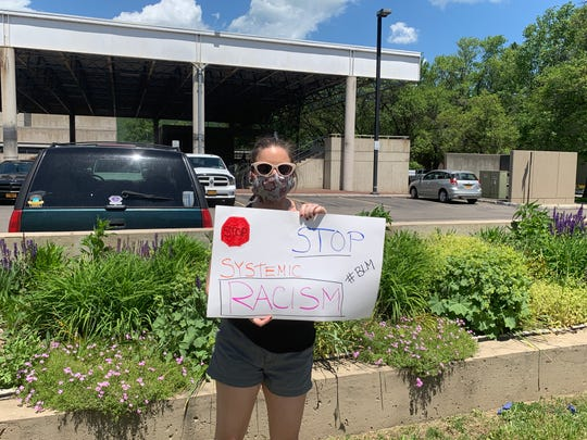 Kecia Nicholson, 38, Corning at the Black Lives Matter march in Corning on June 6, 2020.