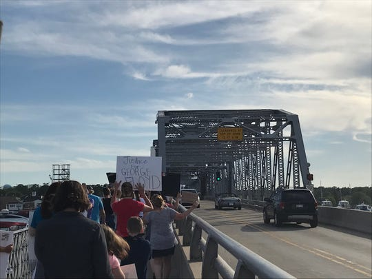 Black Lives Matter protesters march across the Michigan Street Bridge in downtown Sturgeon Bay on June 4, 2020.