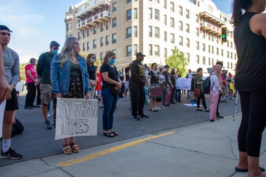 The crowd at the National Day of Action for Black Lives Matter protest in Great Falls pauses for a moment of silence in honor of George Floyd, who was killed by police officers in Minnesota. The silence lasted eight minutes and 46 seconds, which is the length of time the police officer kept his knee pressed on Floyd's neck.