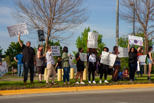 Hundreds of community members in Great Falls attended the local National Day of Action for Black Lives Matter protest. The event began on the steps of the Civic Center, protesters eventually marched on sidewalks, obeying traffic laws, to line the Central Avenue bridge in front of the Federal Courthouse on the west bank of the Missouri rive on Friday, June 5, 2020.