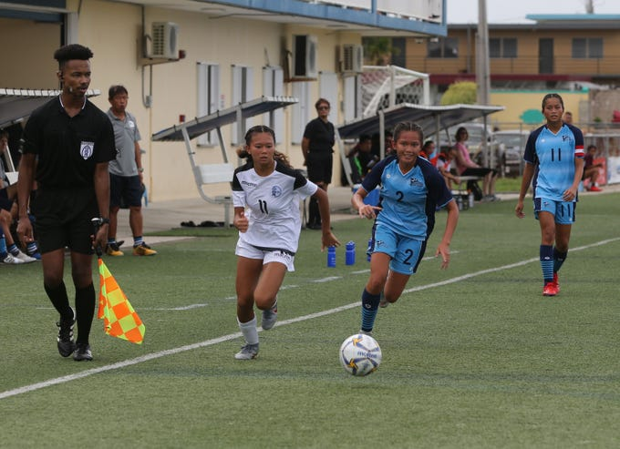 Guam's Yasmeen Lopez gets in a foot race to the ball in a U19 Women's Competition match against the Northern Mariana Islands during the 2019 Marianas Cup tournament held at the Guam Football Association National Training Center last year in this file photo. National Team training came to a halt in mid March due to the COVID-19 virus pandemic. After close to three months, selected teams will begin restricted, non-contact training sessions Monday following new procedures to comply with precautionary government mandates, such as social distancing.