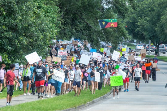 Protesters march peacefully down Camellia Blvd to call attention to police brutality and white silence. Saturday, June 6, 2020.