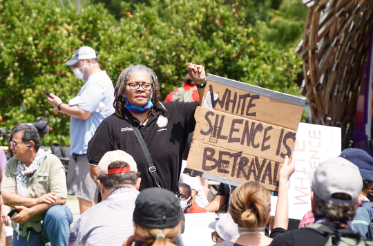 Lafayette NAACP President Marja Broussard leads protestors in an eight minute, forty-six second demonstration of silent kneeling in memory of George Floyd during the March to End White Silence and Police Brutality in Lafayette Saturday.