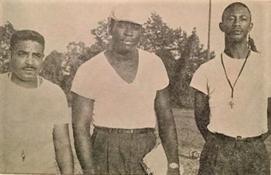 Deacons Olen Satcher (left) and F.D. Kirkpatrick (middle) stand with associate Willie Stringer (right). Kirkpatrick and Satcher were coaches at Jackson High School in Jonesboro.