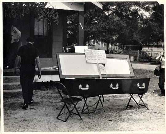 """Jonesboro Klansmen placed a coffin outside of the Freedom House to intimidate CORE workers. Written on the sign: """"Martin Luther King member of or accepts support from- over 60 communist fronts (Karl Prussian FBI Counterspy)."""""""