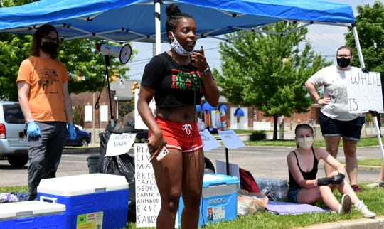 Alexis Sanford, 29, of Lancaster, speaks out against police brutality and racism while sharing personal experiences during a protest in downtown Lancaster June 6.