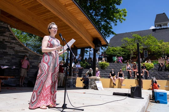 Event organizer Jessica Garcia speaks to open the event's discussion of white allyship for people of color Saturday, June 6 at the Brighton Mill Pond.