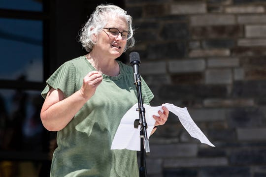 Livingston Diversity Council Holly Ward Lamb speaks during an event described as Brighton Allies for Racial Justice Saturday, June 6 at the Brighton Mill Pond.