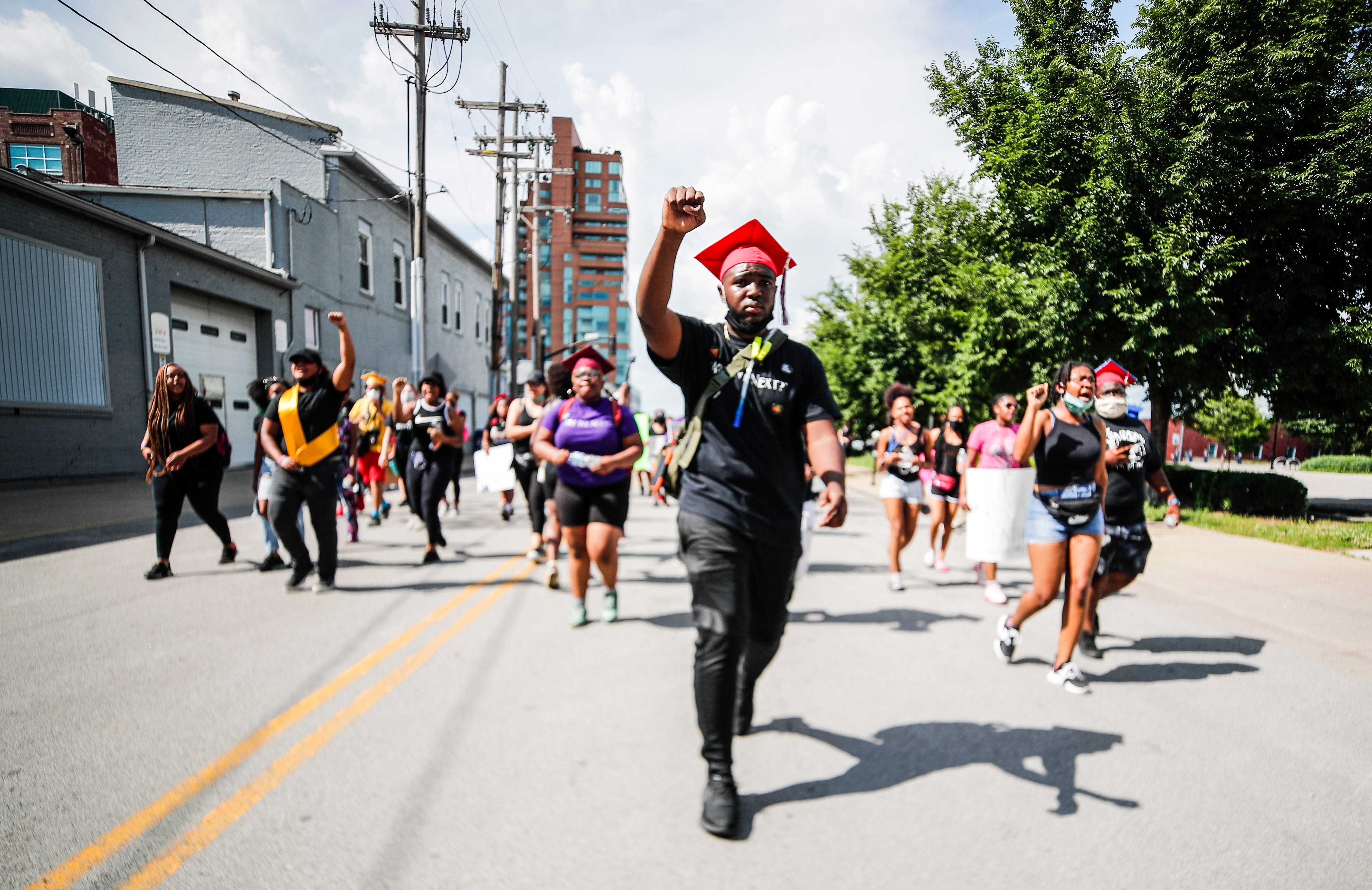 """""""We're marching for something bigger,"""" said Savion Briggs, a 2020 Butler High School graduate. """"Only way we're going to stop racism is solidarity. I shouldn't have to fear for my life just for the way I look."""" Briggs, among others, decided to wear their graduation caps as they marched and spoke for justice for Breonna Taylor in June 2020."""