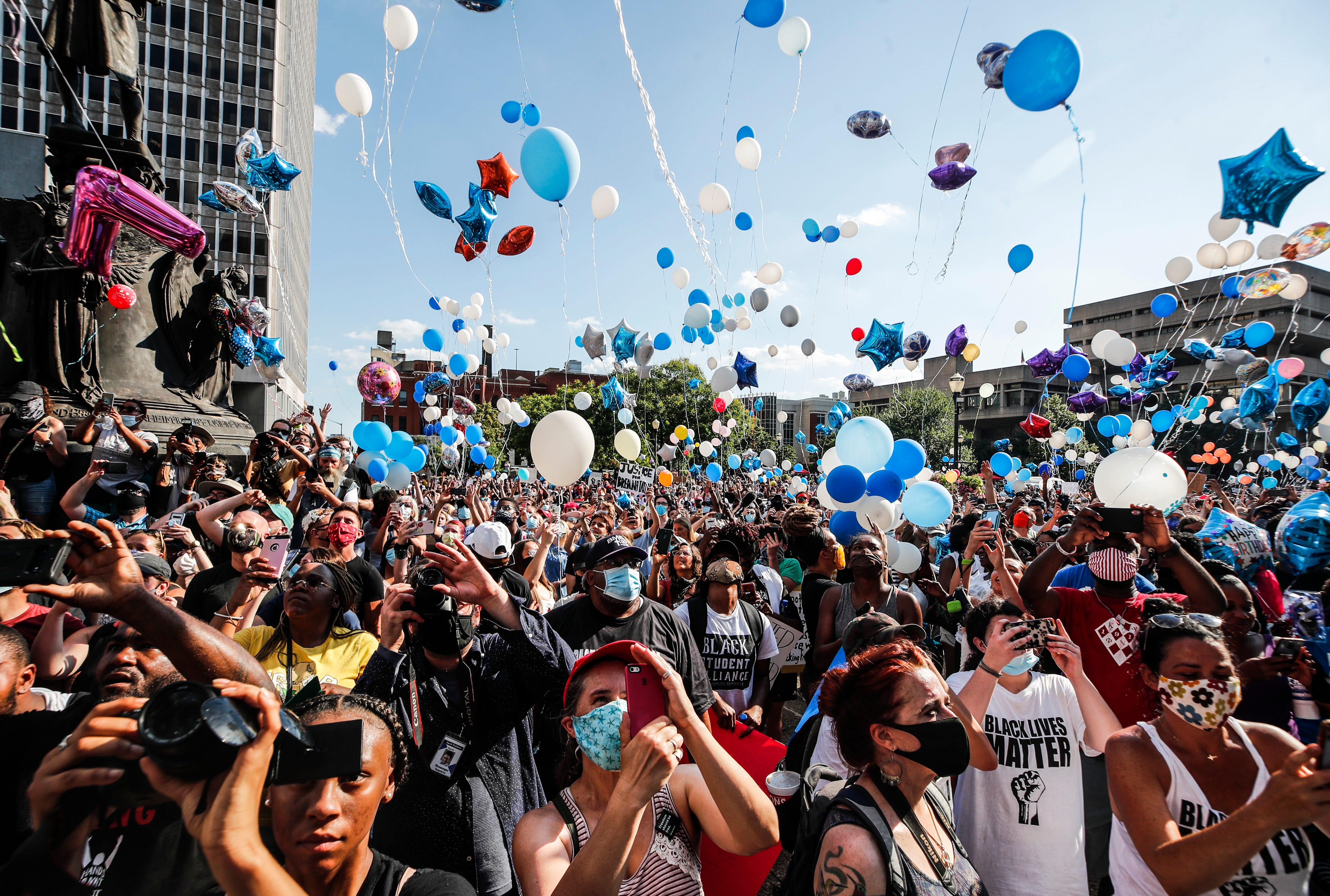 Thousands of balloons were released from a crowded Jefferson Square in remembrance of Breonna Taylor, the 26-year-old EMT killed in her sleep by LMPD during a 'no-knock' raid.