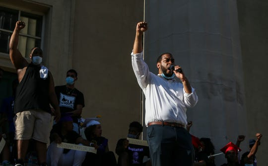 Senate hopeful Charles Booker speaks at a protest over Breonna Taylor's killing in Louisville.