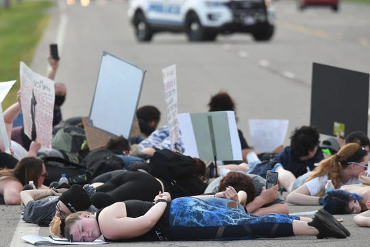 West Fourth street was blocked for 8 minutes and 46 seconds Friday evening by protesters honoring George Floyd and protesting the treatment of black people.