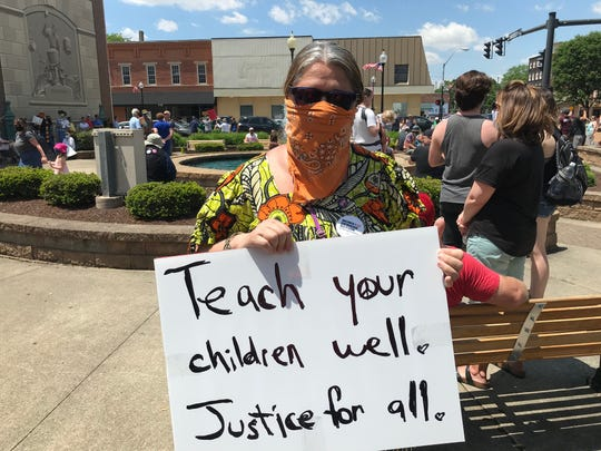 Lisa Miller of Bucyrus attends the Black Lives Matter peaceful protest Saturday in Bucyrus.