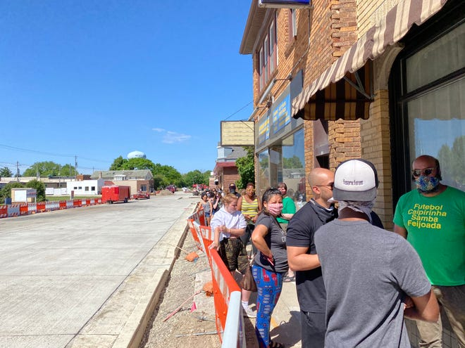 The line outside of Cream City Print Lounge was long as people waited outside due to COVID-19 restrictions.