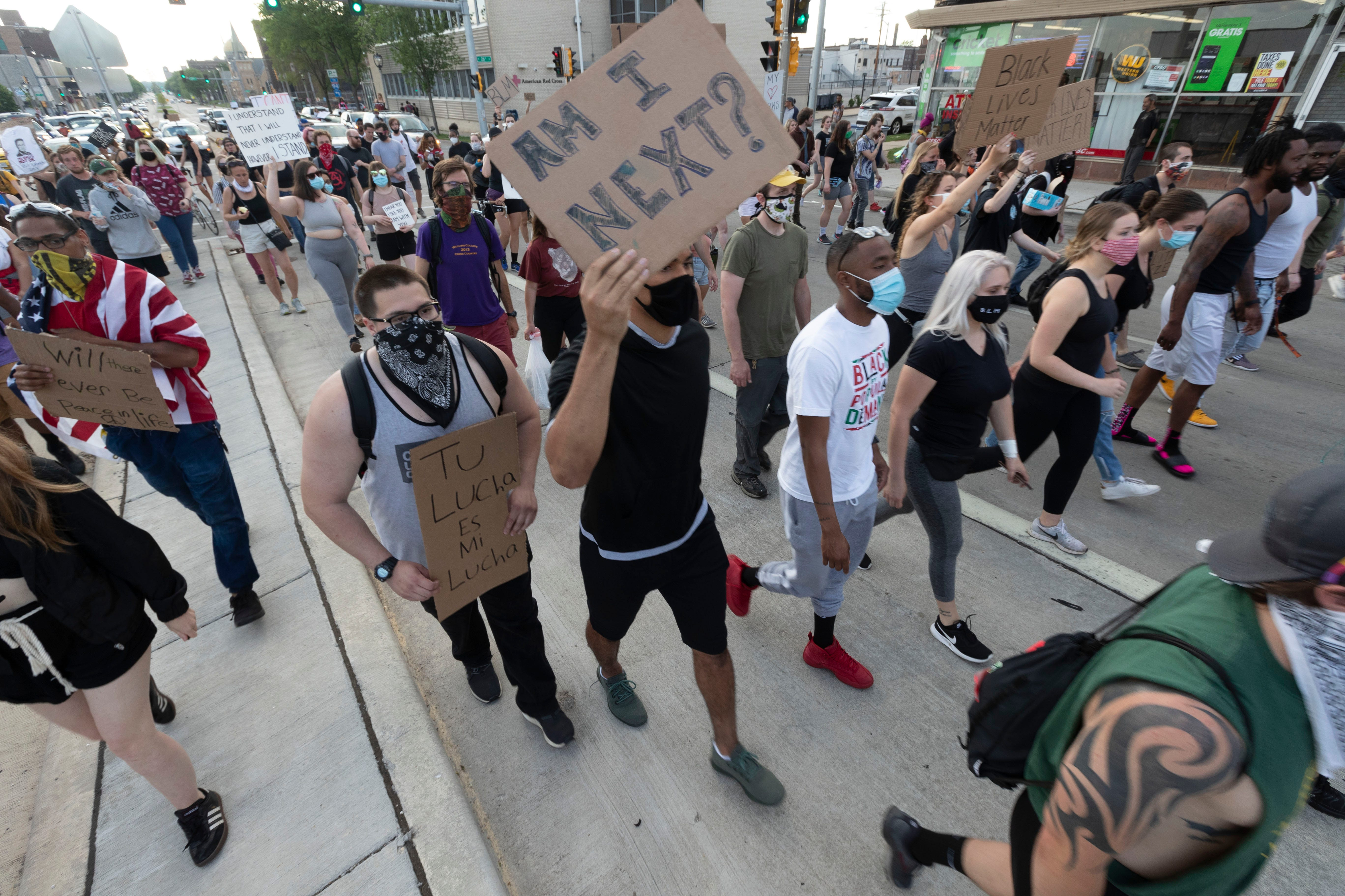 About 200 marchers make their way east on Wisconsin Ave. as part of a Black Lives Matter protest Friday, June 5, 2020 Milwaukee, Wis.