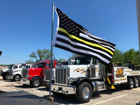 An American flag designed to honor tow truck drivers is displayed on the back of a truck on Saturday to honor the memory of Ramon Echeverria.