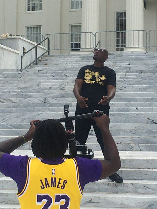 """Montgomery hip hop artist and producer YunRo shoots a video on the front steps of the Alabama State Capitol for his new song """"Street Life"""" on Saturday, June 6, 2020 in downtown Montgomery, Ala."""
