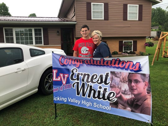 Ernest White and his foster mom, Tammy White, are still celebrating his graduation from Licking  Valley, and his prized 2015 Mustang, after a challenging life that saw him nearly die as an infant.