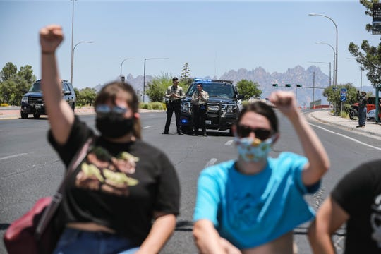 Demonstrators protest police brutality while marching along Lohman Avenue in Las Cruces on Saturday, June 6, 2020.