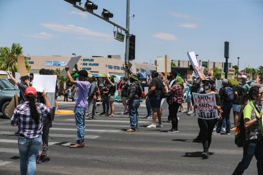 Demonstrators protest police brutality while standing in the crosswalks at the Lohman Avenue and Walton Boulevard intersection in Las Cruces on Saturday, June 6, 2020.