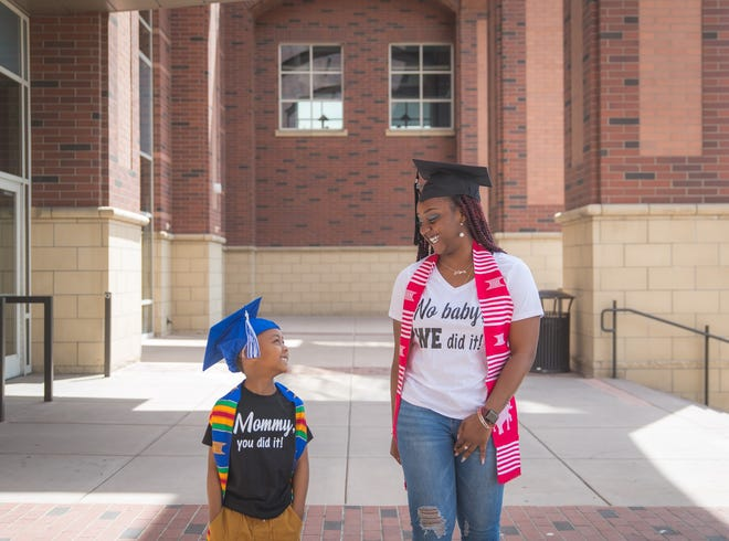 KaPreace Young and her 6-year-old son celebrate her recent graduation with a masters degree from the University of Nevada, Reno.