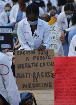 Several large groups of protesters gathered peacefully in Niagara Square in downtown Buffalo Friday, June 5, 2020.  One large group that had approximately 300 or more people marched to nearby Lafayette Square. A group of doctors, nurses and other healthcare professionals came from a variety of hospitals in Buffalo.