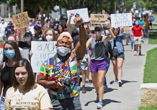 Hundreds of people march on the campus of Angelo State University in San Angelo on Saturday, June 6, 2020.