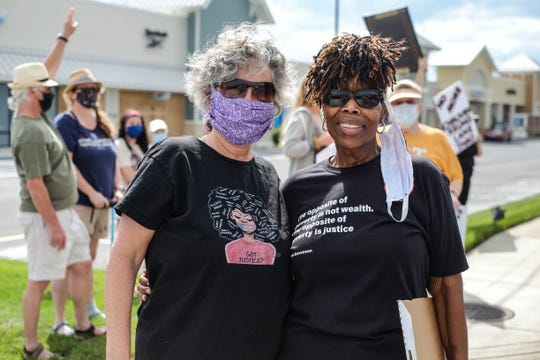 Donna Davis and Gail Jackson have been together 34 years. They stood on Coastal Highway in Rehoboth Beach on Friday to protest the death of George Floyd and systemic racism. June 5, 2020.