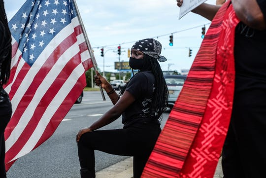 Nearly 600 protesters stood along Coastal Highway in Rehoboth Beach on Friday, demanding justice for George Floyd. June 5, 2020.