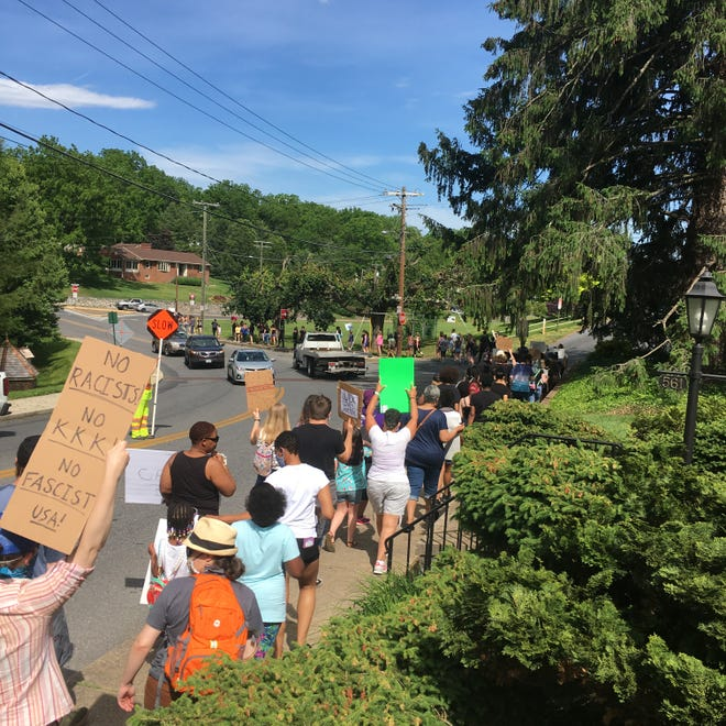 The Silent March winds its way down Thornrose Avenue and onto Churchville Avenue to downtown Staunton.