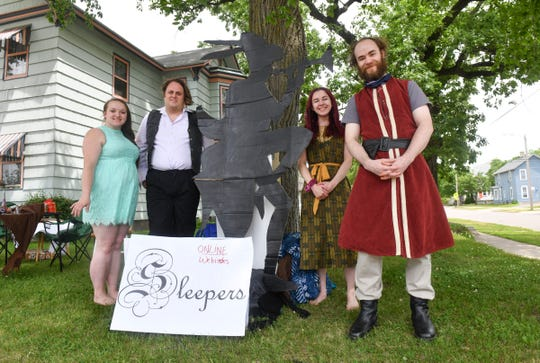 Sara Hillyer, Kaleb Fischer, Kilie Anderson and Kenny Simon stand near displays promoting their upcoming production of ÒSleepersÓ during the Drive By Art Show Saturday, June 6, 2020, in St. Cloud.