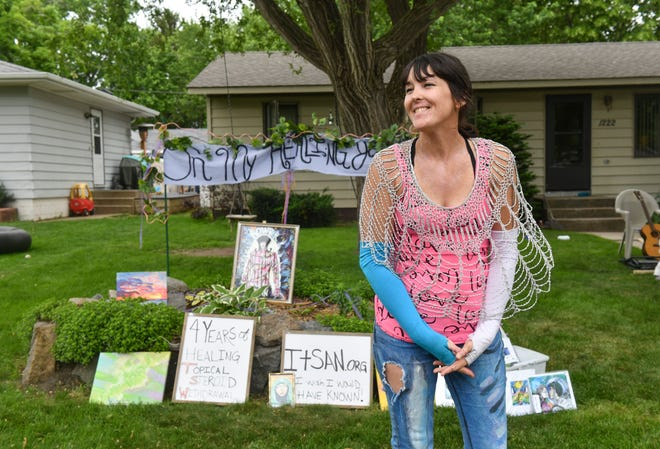 Kelli Henry smiles while talking about community involvement in the Drive By Art Show Saturday, June 6, 2020, in St. Cloud.