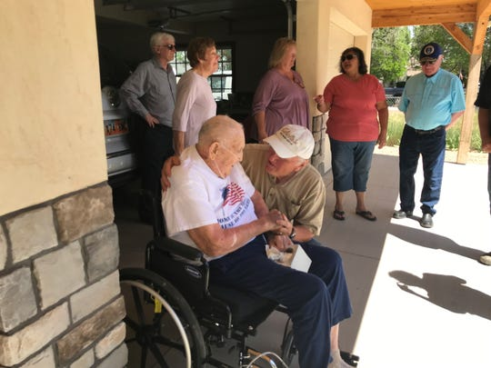 Roddy Roper, in the wheelchair, greets community members on June 5, 2020, following the presentation of his two bronze stars for acts of valor during World War II.