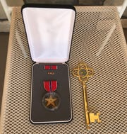 World War II veteran Roddy Roper received two bronze medals for valor and a key to the city of Enterprise on June 5, 2020.