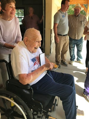 Roddy Roper poses with his bronze star medals, awarded on June 5, 2020, for acts of valor during World War II.
