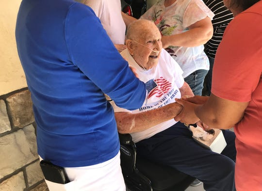 Roddy Roper greets community members on June 5, 2020, following the presentation of his two bronze stars for acts of valor during World War II.