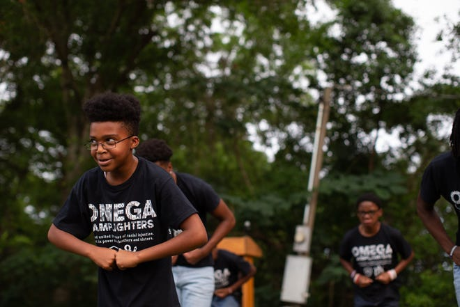 The Omega Lamplighters perform during a community gathering at Walker Ford Community Center Friday, June 5, 2020.