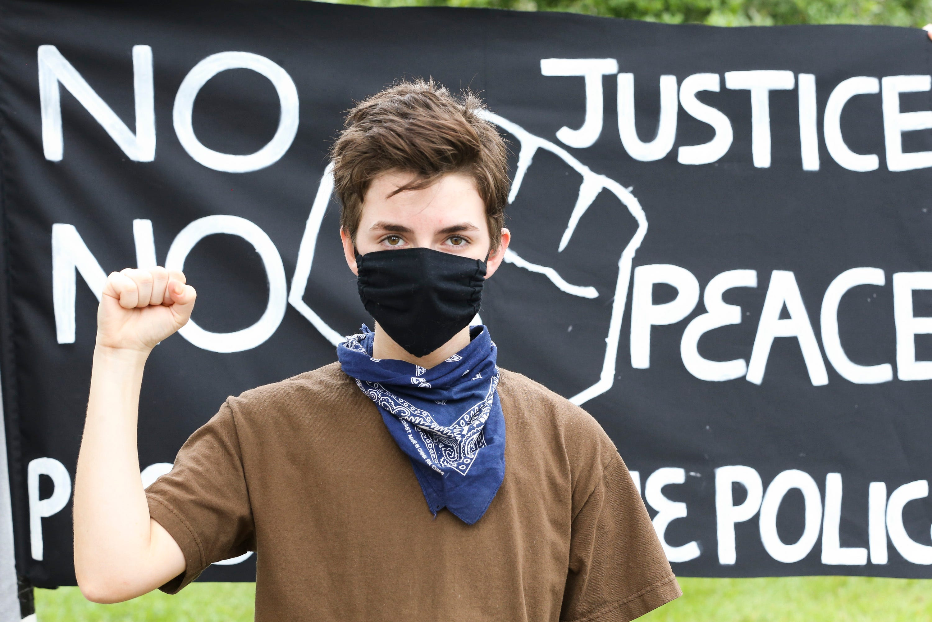 """Nico Rovito,16, of Fort Pierce, attends the peace and justice demonstration at Port St. Lucie City Hall on Saturday, June 6, 2020, in Port St. Lucie. Port St. Lucie police were in the area for the event in a show of unity. The gathering was a call for justice after the death of George Floyd in Minneapolis police custody on May 25. """"I want to use the power that I have and the privilege that I have to help stop the oppression that is going on,"""" said Rovito."""